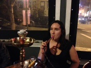 Hookah is part of Nadia's Moroccan culture. Tonight she enjoys it thousands of miles from home.