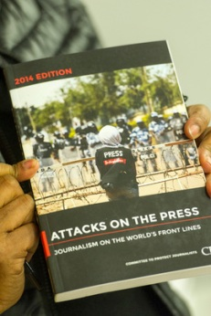 "A press conference was held at UN Headquarters to present the annual report of the Committee to Protect Journalists (CPJ), ""Attacks on the Press – 2014 edition"". A close-up of a copy of the report. 12 February 2014 Photo courtesy of the UN Archive"