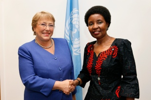 Former Deputy Secretary-General Louise Frechette shaking hands with Head of UN Women Phumzile Mlambo-Ngcuka. UN photo