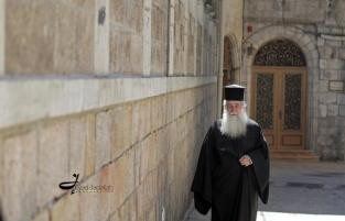 A priest walking in the old city of Jerusalem - Eyad Jadallah/ 2012