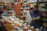 A spice merchant in one of Jerusalem's old markets in the old city - Eyad Jadallah/ 2012