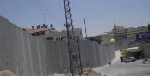 Israeli separation barrier at Abu Dis, June 2004. This picture shows a portion of the barrier being built by Israel in the West Bank. This part is in Abu Dis, close to the eastern part of Jerusalem. The photo was taken on the Jerusalem side of the wall, facing south. The local residents on both sides of the barrier at this point are predominantly Arabs. (Photo by Matanya)